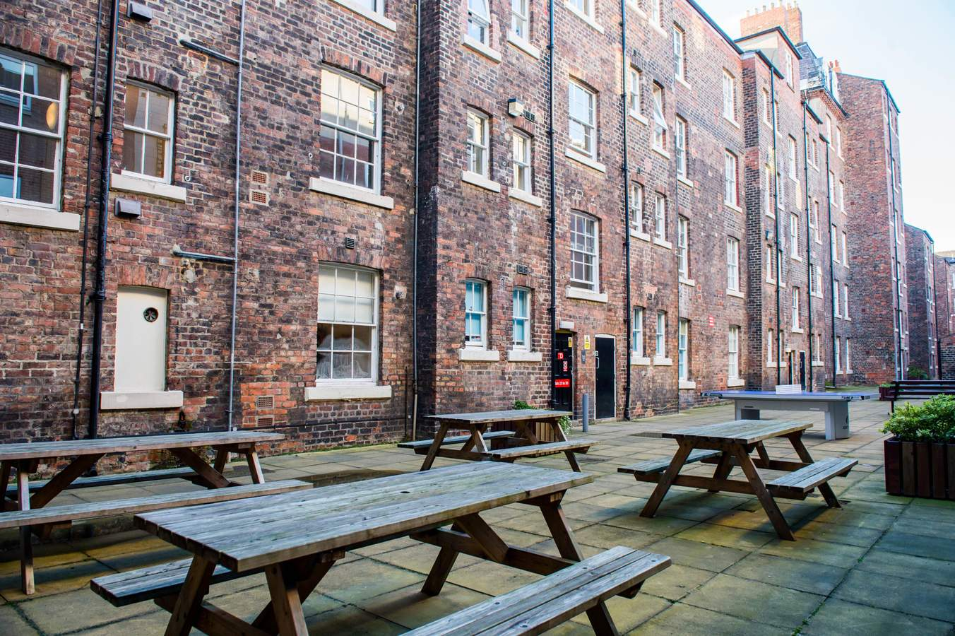 Garth_heads_-_courtyard_03_(low_res)